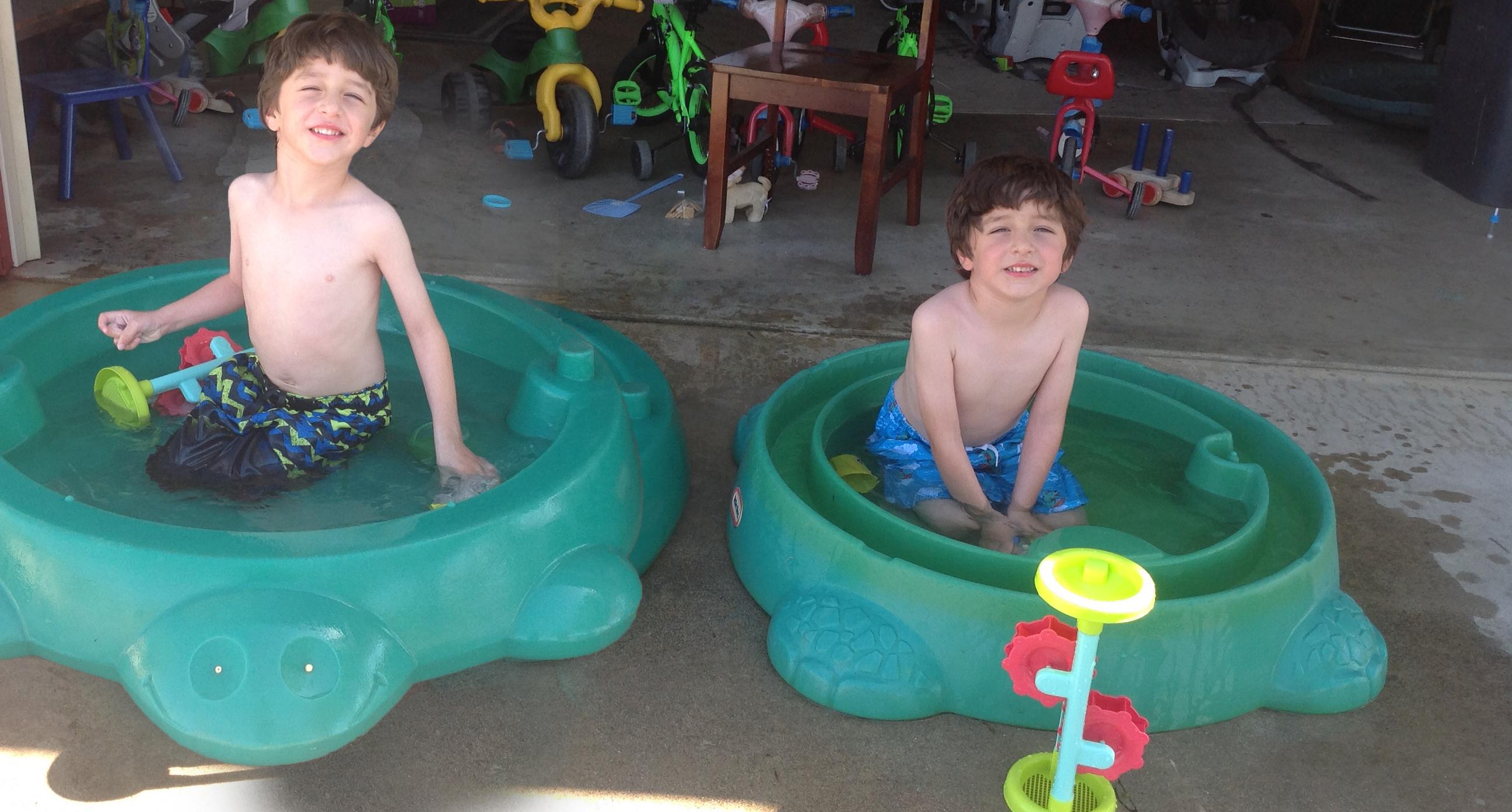twins in pool